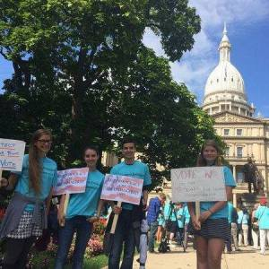 Three of our campers rallying at the Michigan State Capitol to speak up for wolves.